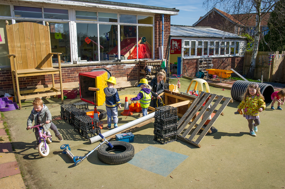 playing-construction-in-garden